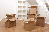 9436253-empty-room-full-of-cardboard-boxes-for-moving-into-a-new-home